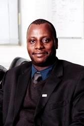Andrew D Kambugu